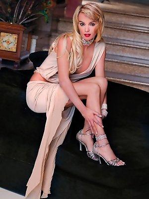 Big boobed slut in classy attire gets fucked